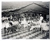 Thumbnail for Indoor Group Shot of Men and Women in front of a Cake, Mary McLain