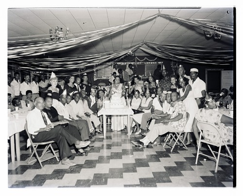 Image for Indoor Group Shot of Men and Women in front of a Cake, Mary McLain