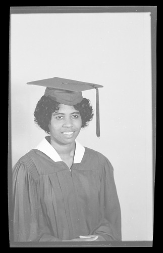 Image for Studio Portrait of a Woman Sitting, Wearing a Cap and Gown