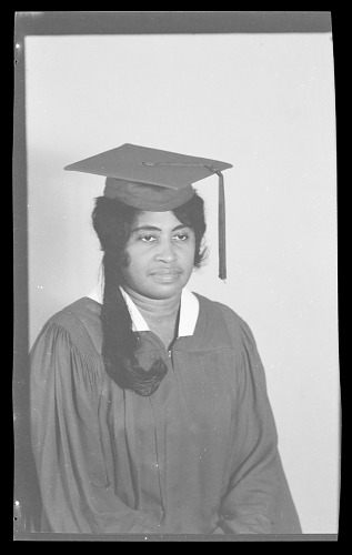 Image for Studio Portrait of a Woman Sitting, Wearing a Cap and Gown, Ezzie Smith
