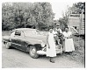 Thumbnail for Outdoor Photo of Two Women with a Man and Child on the Hood of a Car