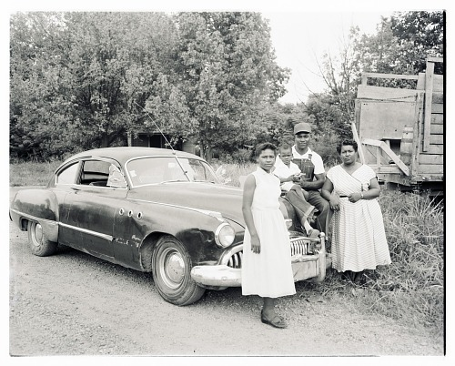 Image for Outdoor Photo of Two Women with a Man and Child on the Hood of a Car
