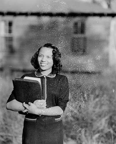 Image for Outdoor Portrait of a Woman Standing Holding Books, Rosie Lee Cory