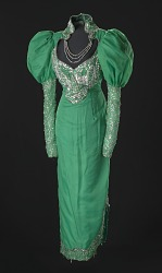 Green dress with silver details and attached necklace designed by Peter Davy