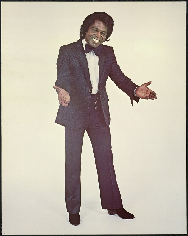 Image for Poster featuring James Brown in a black suit and bowtie