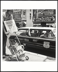 William Edwin Jones pushes daughter Renee Andrewnetta Jones (8 months old) during protest march on Main St. in Memphis Tennessee.
