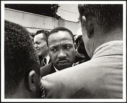 Dr. Martin Luther King, Jr. is stopped by police at Medgar Evers' funeral, Jackson, MS