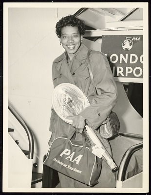 Photograph of Althea Gibson with travel gear