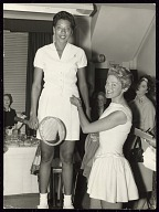 Photographic print of Althea Gibson standing on a chair