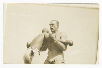 Photographic postcard of Jack Johnson and James J. Jeffries clinching