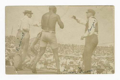 Image for Photographic postcard of James J. Jeffries staggering away from Jack Johnson