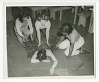 Thumbnail for Photograph of four young women practicing first aid