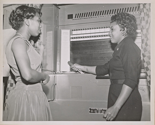 Image for Photograph of a young woman demonstrating use of voting machine