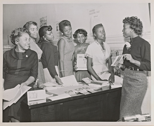 Image for Photograph of seven Junior NCNW members with voter information pamphlets