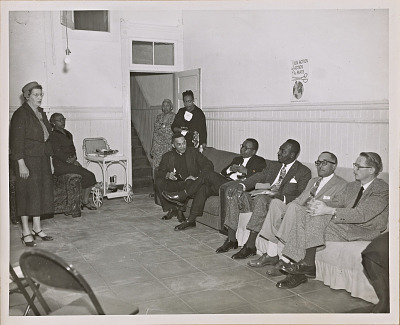 Photograph of a coffee hour for leading San Francisco ministers held by the NCNW