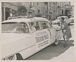 Photograph of Ruth March decorating the car at the head of a NCNW motorcade