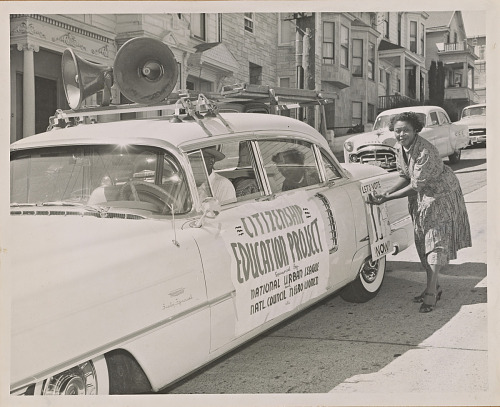 Image for Photograph of Ruth March decorating the car at the head of a NCNW motorcade