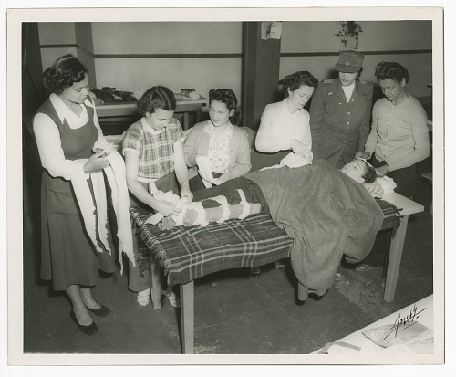 Image for Photograph of Frances Albrier instructing a first aid class