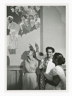 Photograph of Frances Albrier gesturing towards a mural of Mary McLeod Bethune