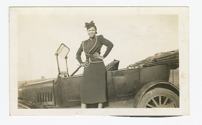 Photograph of Odessa Jones Murray in front of a car