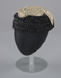 Black raffia hat with cream embellishments from Mae's Millinery Shop