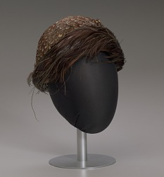 Brown feathered hat from Mae's Millinery Shop
