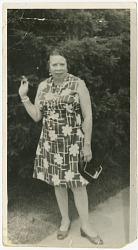 Photograph of Mae Reeves standing outdoors