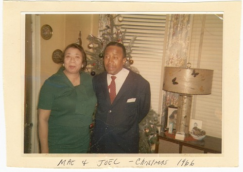 Image for Photograph of Mae & Joel Reeves in front of a Christmas tree
