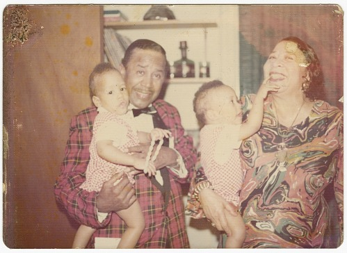 Image for Photograph of Mae & Joel Reeves holding two young children