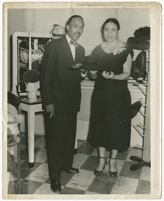 Photograph of Joel and Mae Reeves in Mae's Millinery Shop