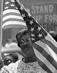 Woman and the Flag July 4 March through Chapel Hill