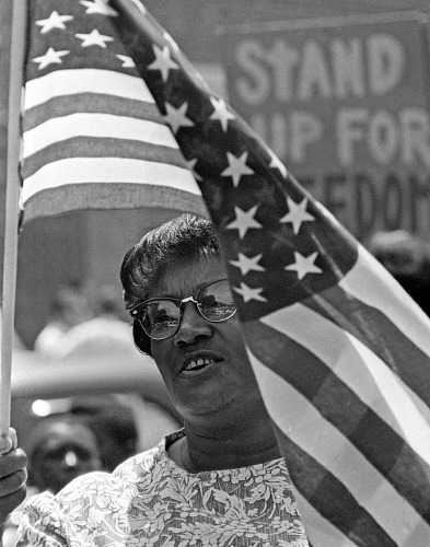 Image for Woman and the Flag July 4 March through Chapel Hill