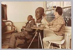 Color photograph of Eubie Blake and artist Bob Walker during modeling sessions