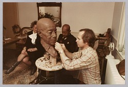 Color photograph of Eubie Blake and artist Bob Walker during a modeling session