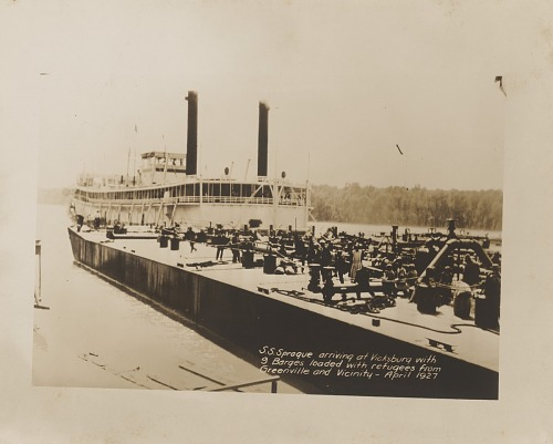 Image for S. S. Sprague Arriving at Vicksburg with 9 Barges Loaded with Refugees from Greenville and vicinity - April 1927