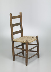 Chair with corn husk seat woven by Johnnie Ree Jackson