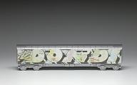 Toy train car with print of grafitti artwork by Dondi White