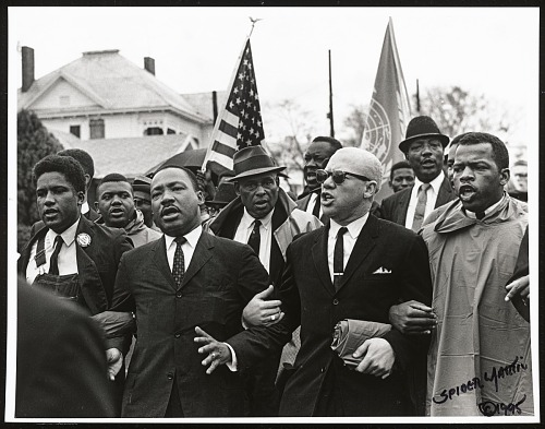 Image for Dr. King Holding Arms; Dr. King, John Lewis, Reverend Jessie Douglas, and James Farmer