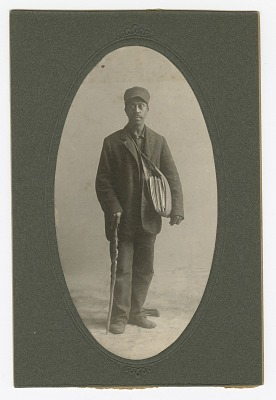 Cabinet card of a newspaper carrier