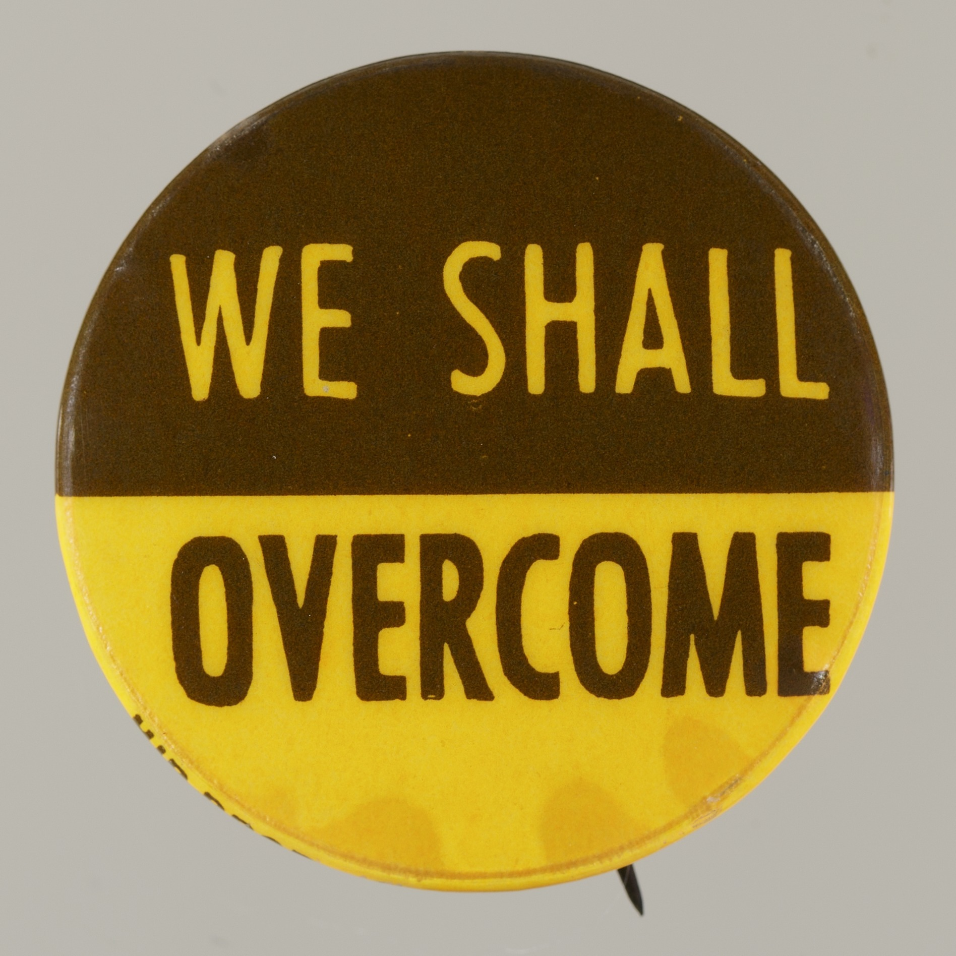 "Image 1 for Pinback button stating ""We Shall Overcome"""