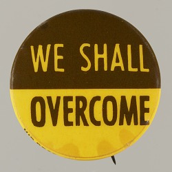 """Pinback button stating """"We Shall Overcome"""""""