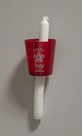 1988 Winter Olympics candle held by Seba Johnson