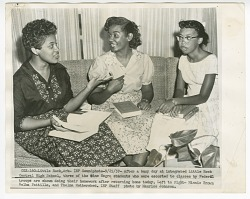 Copy photo of Minnie Brown, Melba Pattillo, and Thelma Mothershed doing homework