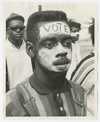 "Photographic print of a man with ""Vote"" face paint in the Selma-Montgomery march"