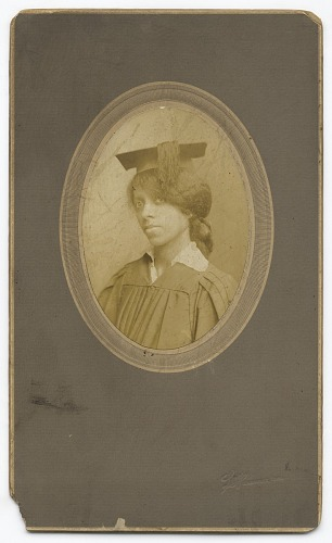 Image for Photograph of Maggie Hickman in a cap and gown