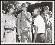 Image for Photograph of Terrence Roberts and soldiers at Little Rock Central High School