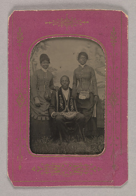 Tintype photograph of James Turner, Master Mason, with two women