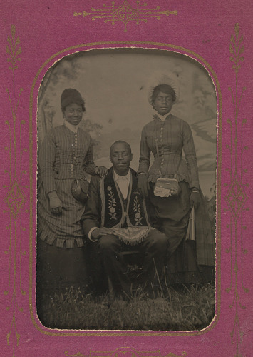 Image for Tintype photograph of James Turner, Master Mason, with two women