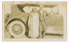 Thumbnail for Photograph of a man and woman in front of car