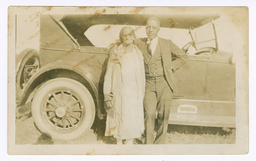 Image for Photograph of a man and woman in front of car